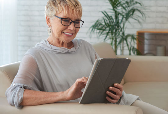Senior woman banking online from home