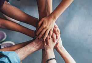 Teamwork displayed as hands holding