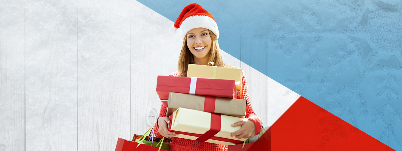 Woman holding gifts wearing a red Santa Hat