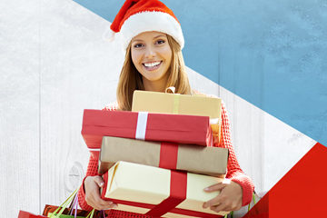 Young lady in a Santa hat holding gifts