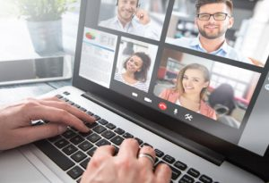 online meeting with several participants viewed on laptop screen