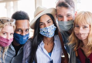 diverse group of friends all wearing face masks