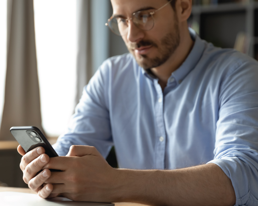 young adult male looking at smartphone