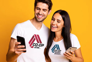 Couple holding smart phones looking at an App